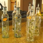 Assorted glass bottles decorated with pressed flowers