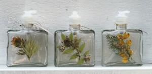 Soap and lotion dispensers decorated with pressed wild flowers.