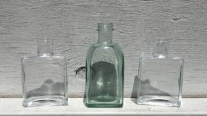 image of clear glass soap and lotion dispensers